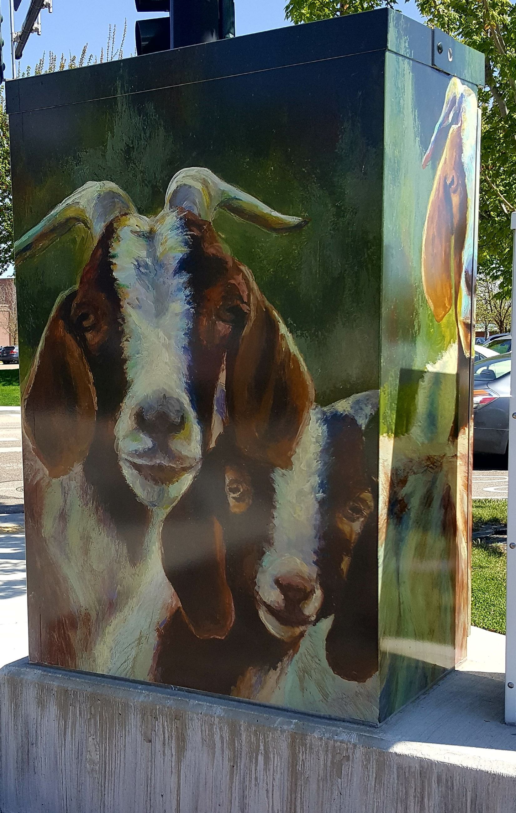 Electrical box painted with images of goats.