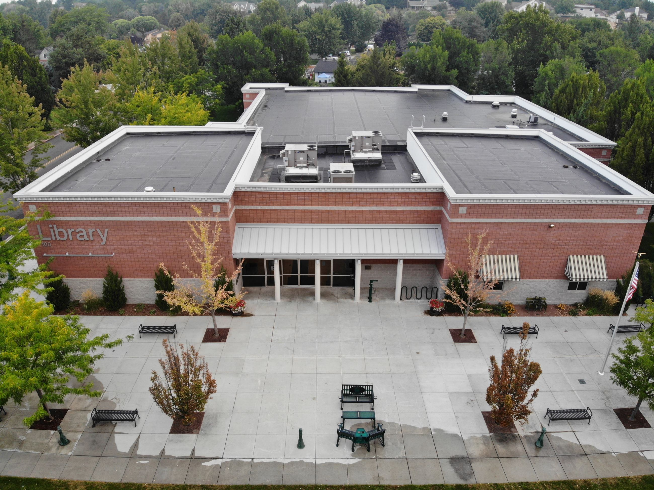 An aerial photo of the front of the Eagle Library. The Eagle Library is a red brick building.