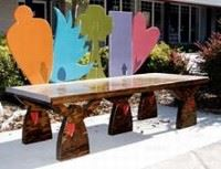 Bench with a Carrot, Wing, Tree, Building, and Heart Making up the Back
