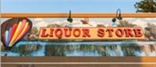 Hot Air Balloon over Water Behind Liquor Store Sign