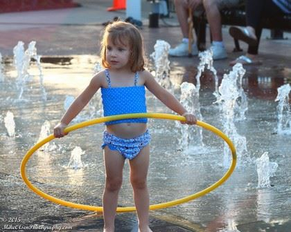 Girl in Swimsuit Playing in Water with a Hula Hoop