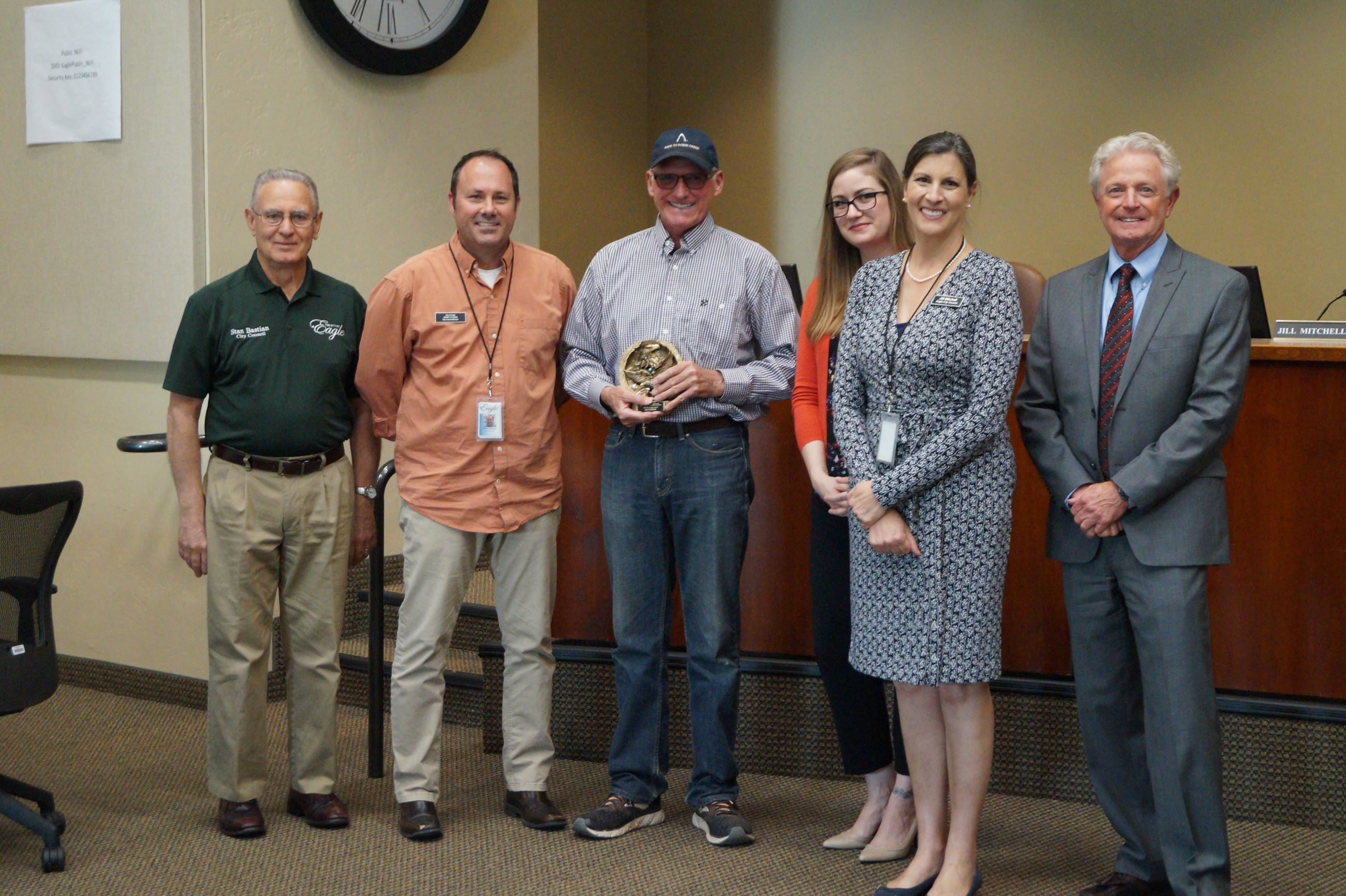 Mayor Stan Ridgeway and City Council members present Dan Friend with a service recognition award for