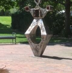 Sculpture with diamond shaped base and crown shaped top at eagle road and plaza drive.