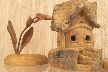 Wooden Carving of a Flower, and a Wood Carving of a Little Stone Brick House