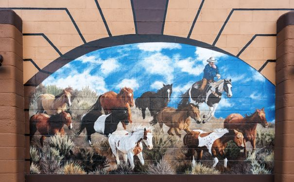 Mural of Cowboy Herding Horses (JPEG) Opens in new window